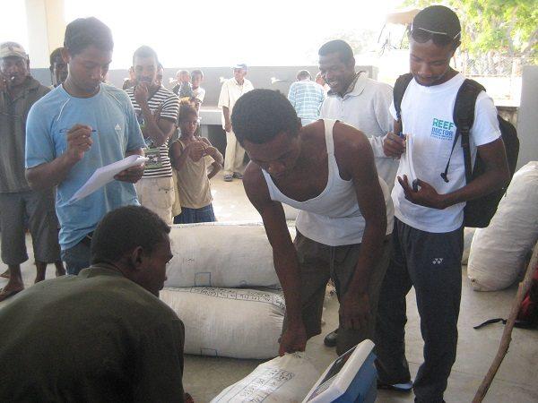 Farmers having their dried seaweed weighed