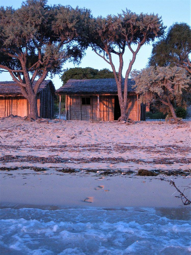 intern huts on beach